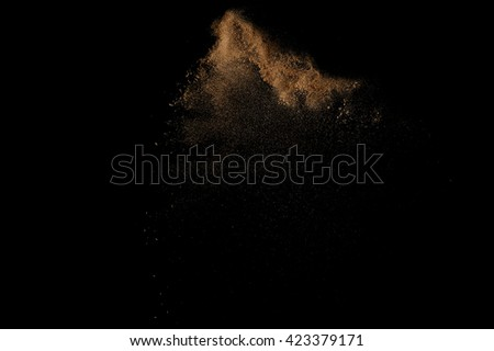 Sandy explosion isolated on black background. Abstract sand cloud. #423379171