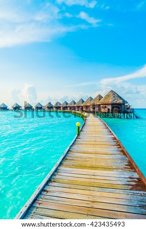 Beautiful tropical Maldives resort hotel and island with beach and sea on sky for holiday vacation background concept -Boost up color Processing #423435493