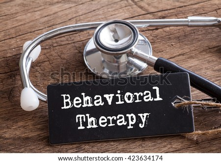 Stethoscope on wood with Behavioral Therapy word as medical concept #423634174