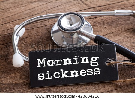 Stethoscope on wood with Morning Sickness words as medical concept #423634216