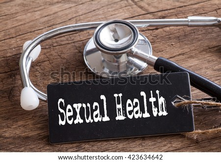 Stethoscope on wood with Sexual Health words as medical concept #423634642