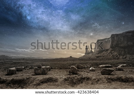 view of a rocky desert landscape at dusk #423638404
