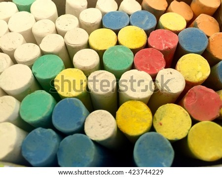 colored chalk for drawing background,Chalks in variety of colors. #423744229
