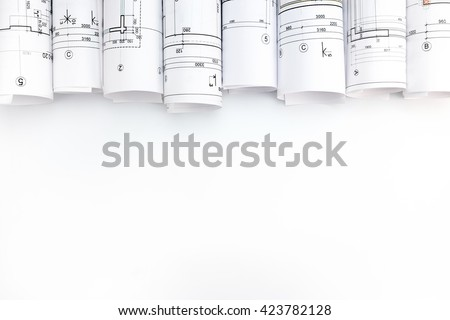 rolls of architecture blueprints and technical drawings on white background #423782128