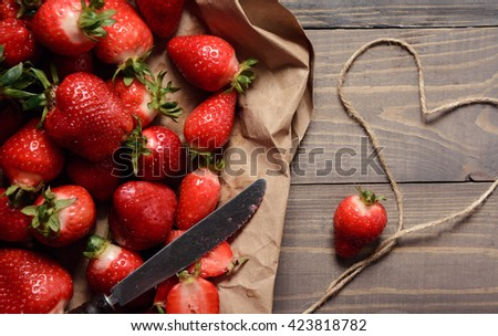Close-up of fresh strawberries on the rustic background. #423818782
