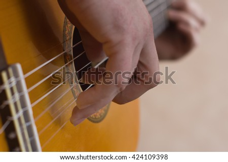 Closeup picture with musician playing guitar #424109398