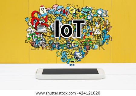 IoT concept with smartphone on yellow wooden background
