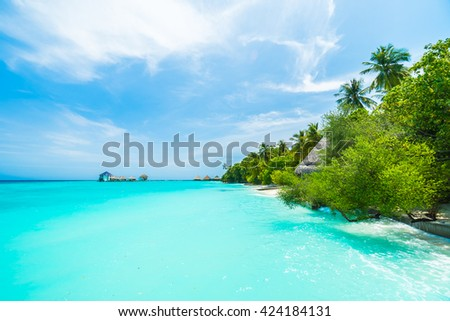 Beautiful tropical Maldives resort hotel and island with beach and sea on sky for holiday vacation background concept - Boost up color Processing #424184131