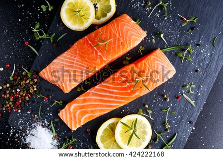 fresh raw salmon fillet with aromatic herbs, spices #424222168