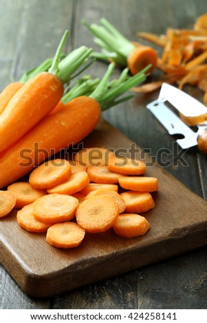 raw carrots on board rustic background #424258141