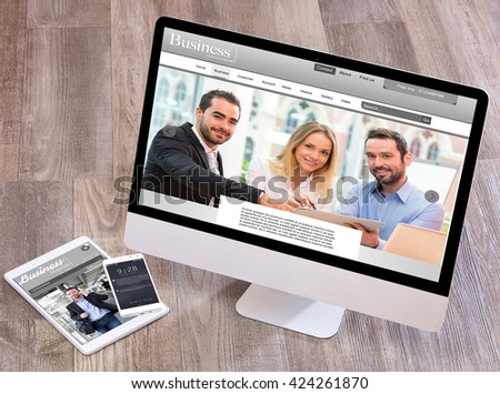 View of a Wood businessman's desk in high definition with laptop, tablet and mobile  #424261870