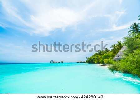 Beautiful tropical Maldives resort hotel and island with beach and sea on sky for holiday vacation background concept - Boost up color Processing #424280149