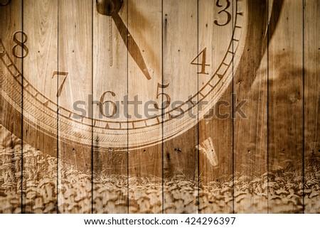 retro closeup clock face on wood background selective focus at number 5 o'clock. #424296397
