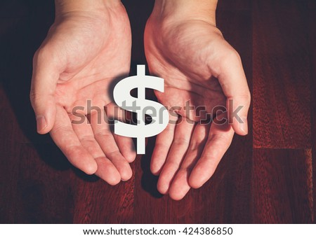 Dollar symbol in hand #424386850