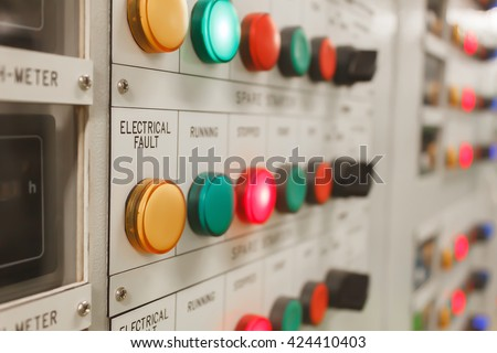 Soft focus electrical fault lighting on control panel board. Royalty-Free Stock Photo #424410403