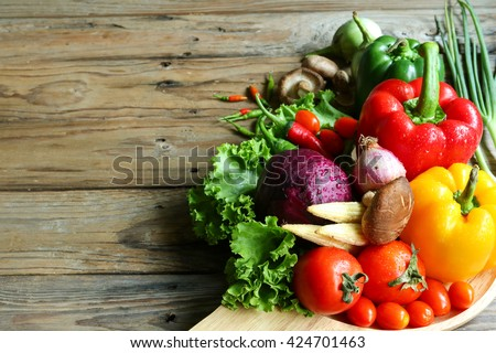 Include vegetables on wooden floor #424701463