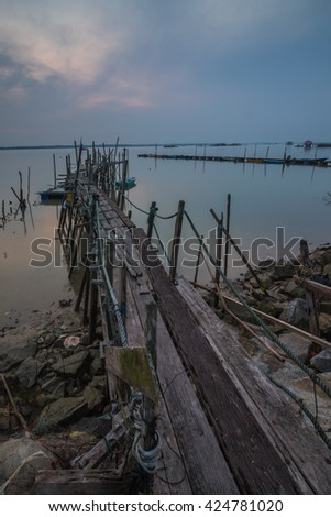 old jetty views during hazy sunset. The image may contain blurry and soft effect due to long expsoure #424781020