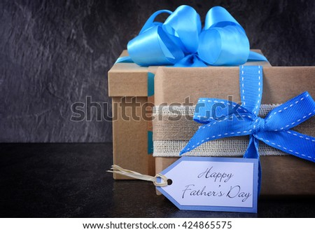 Happy Fathers Day gift on black slate background.