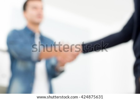 Blur casual businessmen making handshake, can be used as background #424875631