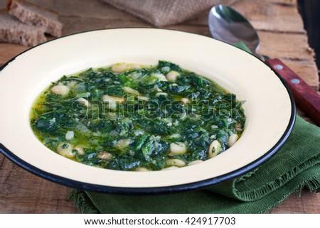 soup of spinach and peas #424917703