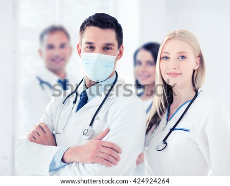 healthcare and medical concept - group of doctors #424924264