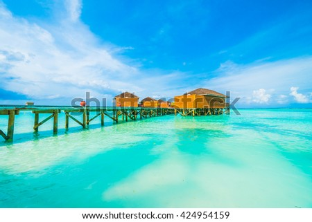 Beautiful tropical beach and sea with water bungalow on blue sky in Maldives island - Boost up color Processing #424954159