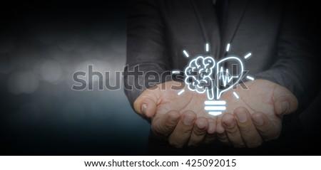 Creative light bulb symbol with heart shape, Idea concept, businessman with ideas and creativity icon. #425092015