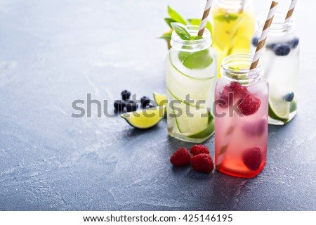 Variety of cold drinks in small bottles Royalty-Free Stock Photo #425146195