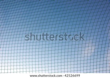 Background of sports net against blue sky #42526699