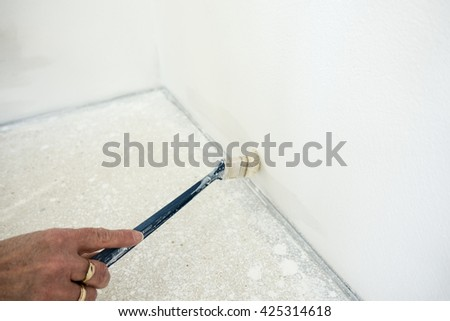 painting inside new house with white color, house renovation tools #425314618
