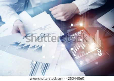Investment manager working process.Concept photo trader work market report modern tablet.Using electronic device.Graphic icons,stock exchange reports screen interfaces.Business startup.Flares effect.