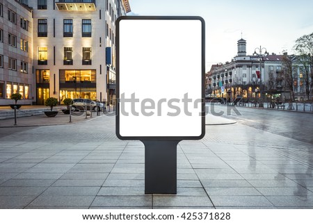 Blank mock up of vertical street poster billboard on city background