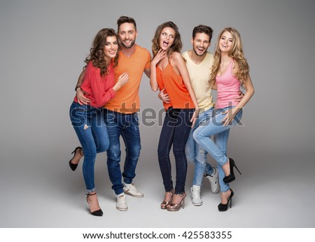 Group of smiling friends in fashionable clothes #425583355