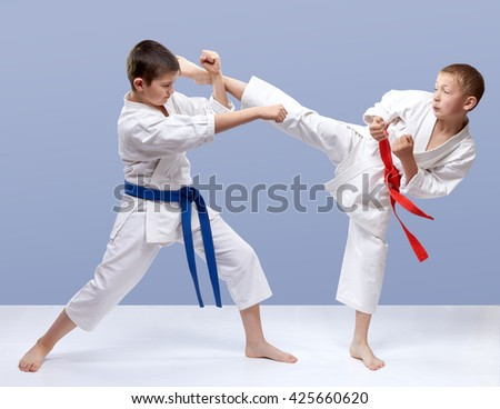 On a gray background boys are beating blows arm and leg #425660620