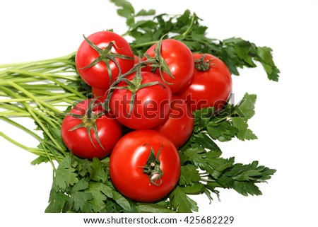 Harvest ripe tomatoes and a bunch of parsley #425682229
