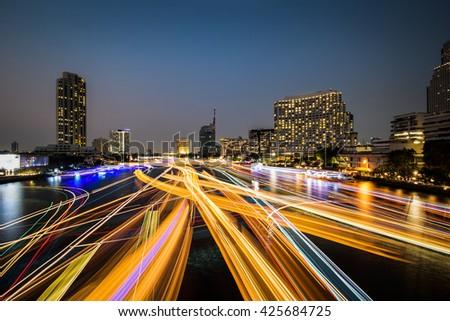 Night light on Taksin Bridge,Bangkok,Thailand.Hotel,Condominium,Modern office near Chao Phra Ya River in the capital of Thailand