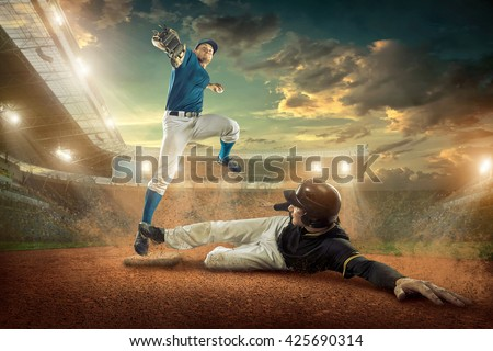 Baseball players in action on the stadium. #425690314