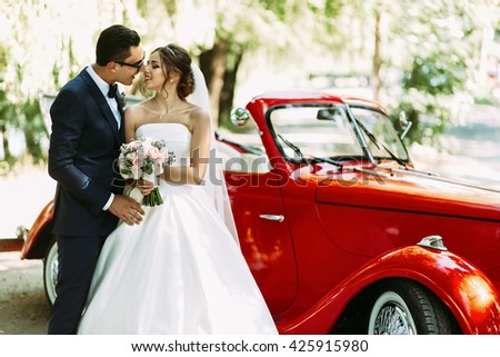 Bride is standing with a bouquet next to a groom #425915980