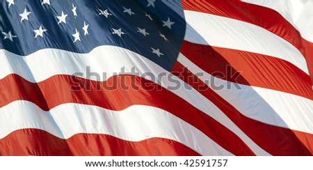 Photo of American flag waving in the wind #42591757