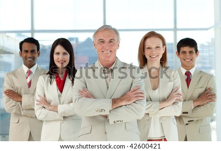 Portrait of a confident multi-ethnic business team in a business building #42600421
