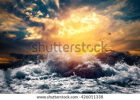 rough sea at sunset #426011338
