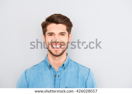Young happy smiling man isolated on gray background #426028057