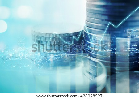 Double exposure of city and graph on rows of coins for finance and banking concept Royalty-Free Stock Photo #426028597