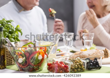 Cropped picture of an elderly couple eating a healthy dinner #426092389