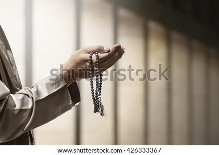 Hand of muslim people praying with mosque interior background Royalty-Free Stock Photo #426333367