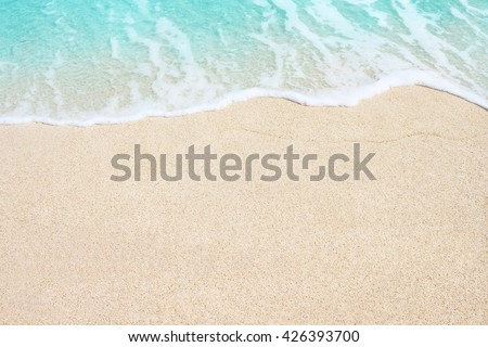 Soft Wave Of Blue Ocean On Sandy Beach. Background. Selective focus. #426393700