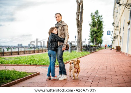 Daughter hugging mother in the park. #426479839