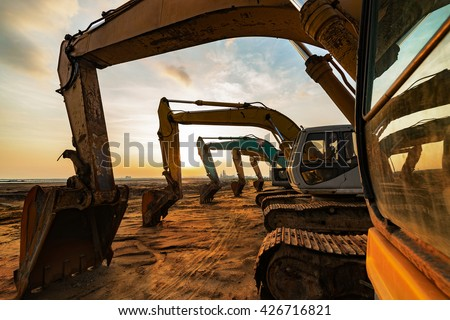 Excavator parked at the site Royalty-Free Stock Photo #426716821
