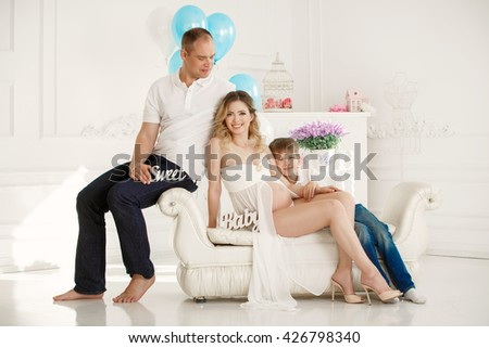 Happy pregnant family at home, pregnancy, Portrait of  man woman and son expecting baby, series #426798340