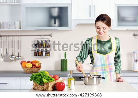 Young woman cooking in the kitchen #427199368